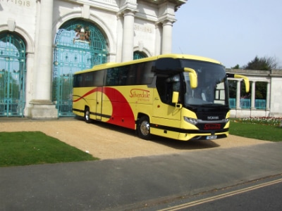 Silverdale coach outside memorial gate
